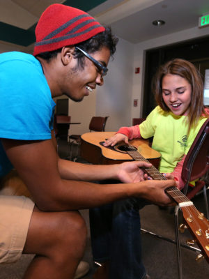 Samantha Pomeroy gets guitar lessons from staff member Vinny Anderson at the Boys & Girls Clubs of Western Nevada in Carson Valley, on Tuesday, March 1, 2016.  Photo by Cathleen Allison