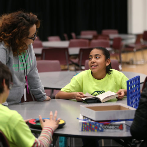 Staffer Maria Bravo, left, talks with Vanessa Del Rio, 11, at the Boys & Girls Clubs of Western Nevada in Carson Valley, on Tuesday, March 1, 2016.  Photo by Cathleen Allison