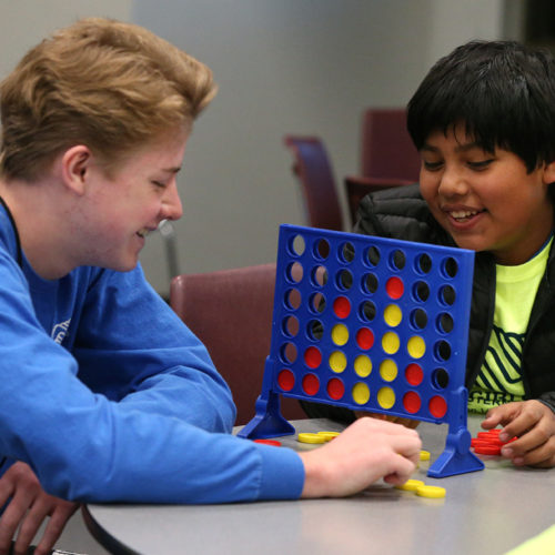 Staff member Dylan Sullivan, left, and Israel Sosa, 11, play games at the Boys & Girls Clubs of Western Nevada in Carson Valley on Tuesday, March 1, 2016.  Photo by Cathleen Allison