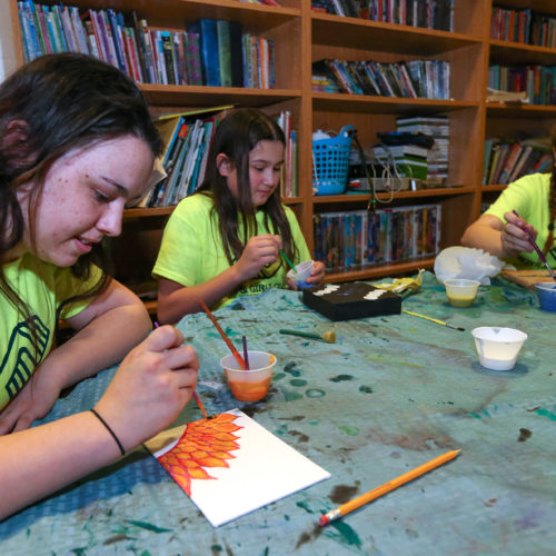 From left, Mikayla Scaramella, 16, Paige Lindsey, 11, and Samantha Cotton, 12, work on artwork at the Boys & Girls Clubs of Western Nevada in Carson Valley, on Tuesday, March 1, 2016.  Photo by Cathleen Allison