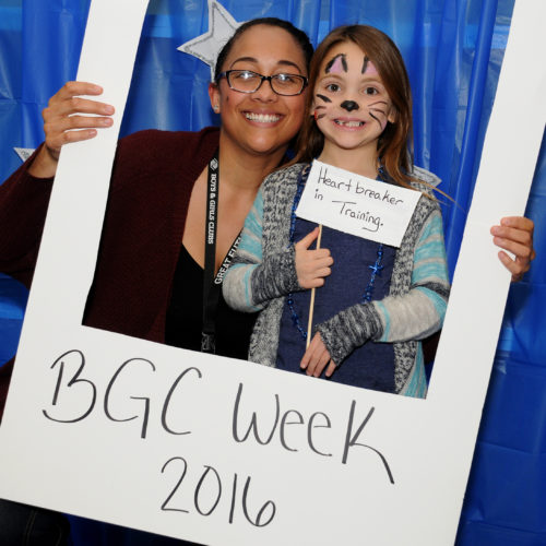 Tiandra Rushing of the Boys & Girls Club and 6-year-old Aylivia Darwich have their picture taken in the photo booth on Friday, March 11, 2016, at the Boys & Girls Clubs of Western Nevada Mardi Gras Day/BGC Night Out Carnival.  Photo by Shannon Litz/Nevada Photo Source