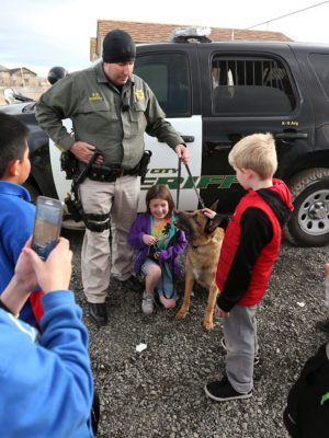Carson City Sheriff's Deputy Jimmy Surratt and his K9 Ary visit with kids on Heroes Day at the Boys & Girls Clubs of Western Nevada in Carson City, Nev., on Tuesday, March 8, 2016. The event is part of Boys & Girls Club of America Week which introduces the community to club programs and rewards members with fun activities.  Photo by Cathleen Allison/Nevada Photo Source