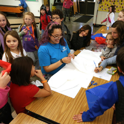 Staffer Ines Castellanos helps members make capes on Heroes Day at the Boys & Girls Clubs of Western Nevada in Carson City, Nev., on Tuesday, March 8, 2016.  Photo by Cathleen Allison