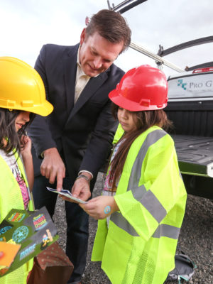 Aaron West, with Nevada Builders Alliance, talks with Alexis Contreras, 8, left, and Nani Garcilazo, 8, during Heroes Day at the Boys & Girls Clubs of Western Nevada in Carson City, Nev., on Tuesday, March 8, 2016.  Photo by Cathleen Allison